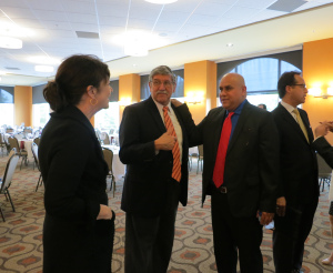 Dean Maloney, Dr. Romo, Antonio González, and Sen. José Menéndez mingle before the reception.