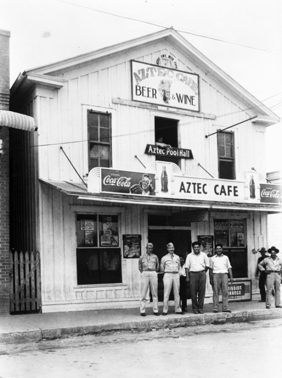 Rudy Domingez (center) and Joe Domingez pose with customers outside their café and pool hall, 18th Street, Hondo, early1940s. (General Photograph Collection, MS 362: 096-0815, courtesy of Eva Arcos )